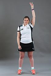 Umpire Rachael Radford signalling held ball