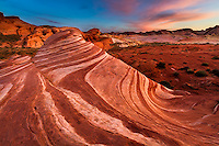 The last light of the day lights up the sky over the Fire Wave in Valley of Fire State Park in Nevada.