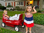 Sept. 11, 2012 - Merrick, New York, U.S. -  LYLA W., 3, and KATE O., 2, helping place 500 Luminary Bags in front of 215 Wenshaw Park homes, on 11th Anniversary of 9/11, by Wenshaw Park Civic Association (WPCA), Long Island, with over $500 already raised for Twin Towers Orphan Fund.