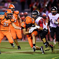 Joshua James carries the ball for the Gallup Bengals and is tackled by Michael Ramsey of the  Grants Pirates at Angelo Dipaolo Memorial Stadium in Gallup, Friday, August 31, 2018.