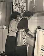 mother and daughter cleaning the dishes, 1940?Äôs