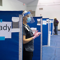RN Cynthia Sanchez waits at her vaccination station for her next patient in the gymnasium on the University of New Mexico-Gallup campus during Gallup Indian Medical Center's COVID-19 vaccination event Saturday morning.