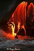 "red hot lava from Kilauea Volcano<br /> spills into the Pacific Ocean in the pre-dawn<br /> Hawaii Volcanoes National Park,<br /> Hawaii Island (""the Big Island""), Hawaiian Islands, U.S.A."