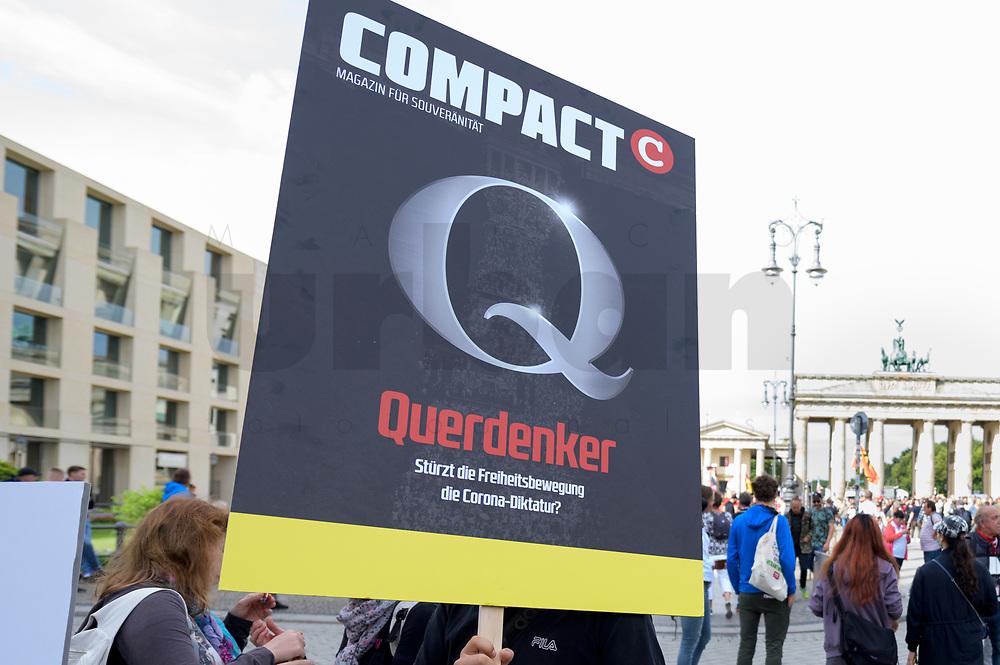"""29 AUG 2020, BERLIN/GERMANY:<br /> Demonstrant mit Plakat """"Compact - Q - Querdenker"""", Demonstration gegen die Einschraenkungen in der Corona-Pandemie durch die Initiative """"Querdenken 711"""" aus Stuttgart unter dem Motto """"invites Europa - Fest für Freiheit und Frieden"""", Pariser Platz<br /> IMAGE: 20200829-01-002<br /> KEYWORDS: Demo, Protest, Demosntranten, Protester, COVID-19, Corona-Demo, Compact Magazin, QAnon"""