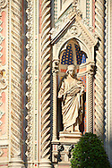 Statue of  of Saint Reparata on the facade of  the Gothic-Renaissance Duomo of Florence,  Basilica of Saint Mary of the Flower; Firenza ( Basilica di Santa Maria del Fiore ).  Built between 1293 & 1436. Italy .<br /> <br /> Visit our ITALY PHOTO COLLECTION for more   photos of Italy to download or buy as prints https://funkystock.photoshelter.com/gallery-collection/2b-Pictures-Images-of-Italy-Photos-of-Italian-Historic-Landmark-Sites/C0000qxA2zGFjd_k<br /> .<br /> <br /> Visit our MEDIEVAL PHOTO COLLECTIONS for more   photos  to download or buy as prints https://funkystock.photoshelter.com/gallery-collection/Medieval-Middle-Ages-Historic-Places-Arcaeological-Sites-Pictures-Images-of/C0000B5ZA54_WD0s