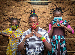 May 2, 2020, Nairobi, Kenya: A man and two children wear colorful masks during coronavirus outbreak in Kenya. (Credit Image: © Donwilson Odhiambo/ZUMA Wire)