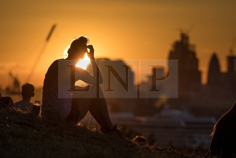 © Licensed to London News Pictures. 23/07/2018. London, UK. The sun sets over London's skyline, as the UK experiences the hottest day of the year so far. The Met Office reported temperatures reached 33.3 degrees celsius in Santon Downham in Suffolk today, and temperatures are set to stay high until the end of this week for the rest of the country. Photo credit : Tom Nicholson/LNP