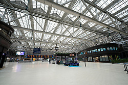 Glasgow, Scotland, UK. 26 March, 2020. Views from city centre in Glasgow on Thursday during the third day of the Government sanctioned Covid-19 lockdown. The city is largely deserted. Only food and convenience stores open. Pictured; Concourse is deserted of passengers at Glasgow Central Station. Iain Masterton/Alamy Live News