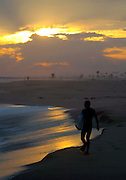 Male Boogie Boarder At Sunset