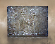 Stone relief sculptured panel of prisoners from the campaign of Elam. From the palace of Ashurnasirpal II  room VI/T1, Nineveh, circa 645 BC. inv 19908  Louvre Museum , Paris .<br /> <br /> If you prefer to buy from our ALAMY PHOTO LIBRARY  Collection visit : https://www.alamy.com/portfolio/paul-williams-funkystock/ancient-assyria-antiquities.html  Refine search by adding background colour, place, subject, museum etc into the LOWER SEARCH WITHIN GALLERY box to <br /> <br /> Visit our ANCIENT WORLD PHOTO COLLECTIONS for more photos to download or buy as wall art prints https://funkystock.photoshelter.com/gallery-collection/Ancient-World-Art-Antiquities-Historic-Sites-Pictures-Images-of/C00006u26yqSkDOM