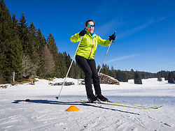 Young woman learning cross country skiing course, Black-Forest, Baden-Wuerttemberg, Germany