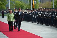 21 MAY 2010, BERLIN/GERMANY:<br /> Angela Merkel (L), CDU, Bundeskanzlerin, und David Cameron (R), Premierminister Grossbritannien, schreiten das angetretene Wachbataillon der Bundeswehr ab, Begruessung mit militaerischen Ehren, Ehrenhof, Bundeskanzleramt<br /> IIMAGE: 20100521-02-005