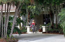 30 July 2015. Marco Island, Florida.<br /> A reporter walks away from the deserted Florida home of Dr Walter Palmer after knocking on the door. The Minnesota dentist who allegedly killed Cecil the lion in Zimbabwe has gone to ground since the story broke, taking him from hunter to hunted.<br /> Photo; Charlie Varley/varleypix.com