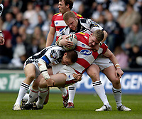Photo: Jed Wee.<br /> Hull v Wigan Warriors. Engage Super League. 30/04/2006.<br /> <br /> Hull tackle Wigan's Danny Tickle.