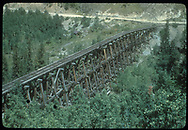 RGS Bridge 45-A at Ophir as viewed from the Ridgway end looking toward Ophir, just out-of-view to the right.  It appears that the rails are still in place, although abandonment has taken place.<br /> RGS  Ophir, CO  Taken by Shank, Robert - 9/1952<br /> Thanks to Don Bergman for additional information.