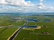Nederland, Friesland, Gemeente Sudwest-Fryslan (Zuidwest-Friesland), 16-04-2012. 'It Lege Midden' (het lage midden). Polder en streek Het Heidenschap met het Zandmeer en Groote Gaastmeer, de Fluezen (Fluessen) aan de horizon...Typical Frisian countryside: lakes, sparse farms in the polders, meadows..luchtfoto (toeslag), aerial photo (additional fee required);.copyright foto/photo Siebe Swart