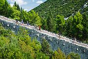 Tourists climbing stairs on the Great Wall, Ston, Dalmatian Coast, Croatia