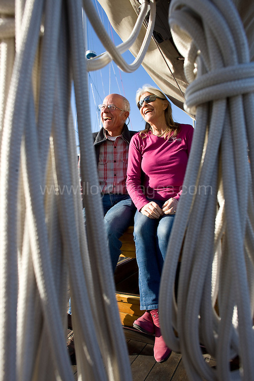 Paul and Jenny Davies, parents of british yachtswomen Sam Davies onboard their classic yacht Ninita. Prior to the Vendee Globe 2012 race start this Saturday. Les Sables d Olonne. France. .Credit: Lloyd Images