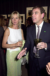 The COUNTESS OF DERBY and HRH The DUKE OF YORK, at a party in London on 25th September 2000.OHH 150