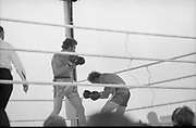 Ali vs Lewis Fight, Croke Park,Dublin.<br /> 1972.<br /> 19.07.1972.<br /> 07.19.1972.<br /> 19th July 1972.<br /> As part of his built up for a World Championship attempt against the current champion, 'Smokin' Joe Frazier,Muhammad Ali fought Al 'Blue' Lewis at Croke Park,Dublin,Ireland. Muhammad Ali won the fight with a TKO when the fight was stopped in the eleventh round.<br /> <br /> Photo shows Bugner in total control of the fight as neilson is hammered back.