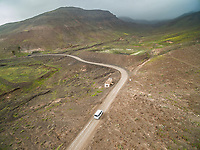 Aerial view of a car on a road of The Natural Park of Jandía in Fuerteventura, Canary Islands.