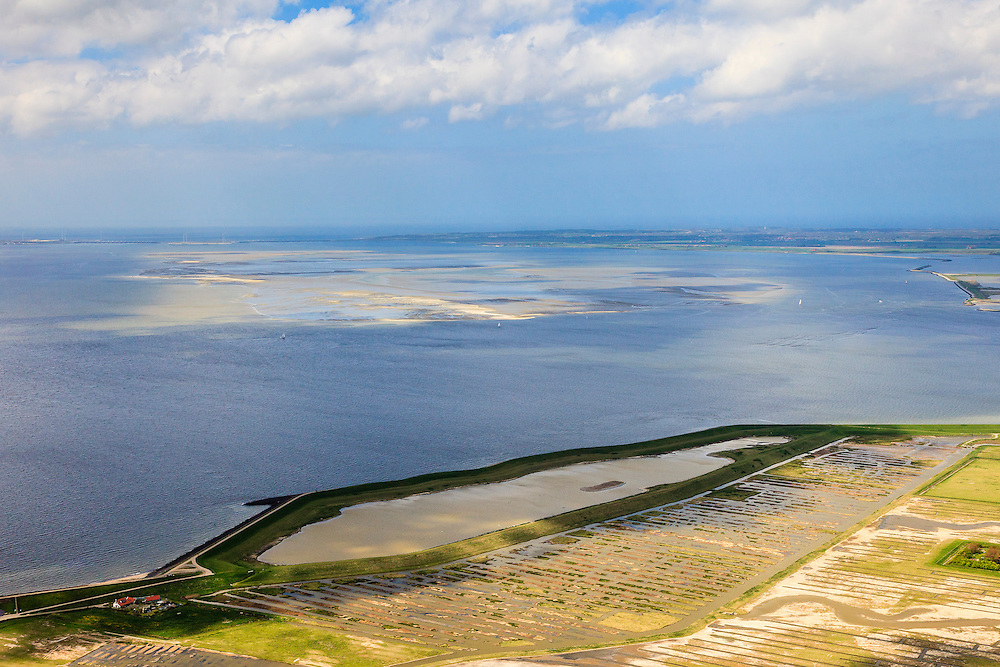 Nederland, Zeeland, Oosterschelde, 09-05-2013; Binnendijkse inlagen ten zuiden van Serooskerke. Landinwaarts zijn polders onder water gezet in het kader van Plan Tureluur. Oosterschelde in de achtergrond.<br /> Nationaal Park De Oosterschelde.<br /> Land between the inner (original) dike and the sea dike near Serooskerke. Polders are inundated under the nature development project Tureluur. Oosterschelde in the background.<br /> luchtfoto (toeslag op standard tarieven);<br /> aerial photo (additional fee required);<br /> copyright foto/photo Siebe Swart.