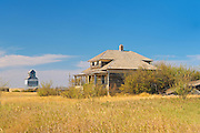 Ghost town with old homestead and grain elevator<br /> Fusilier<br /> Saskatchewan<br /> Canada
