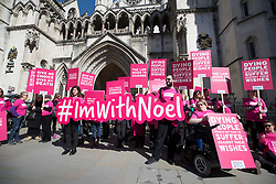 "© Licensed to London News Pictures. 01/05/2018. London, UK. Supporters of terminally ill man Noel Conway demonstrate outside The High Court as he challenges the law on assisted suicide. Mr Conway, who has motor neurone disease, is asking judges to acknowledge his ""basic right to die"". Photo credit: Peter Macdiarmid/LNP"