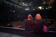 Francis Rossi and of Status Quo sit on the stage after their sound check while on European tour at L'Aeronef in Lille, France.
