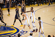 Golden State Warriors forward Kevin Durant (35) smacks guard Klay Thompson (11) in the head after hitting 53 points against the Indiana Pacers at Oracle Arena in Oakland, Calif., on December 5, 2016. (Stan Olszewski/Special to S.F. Examiner)