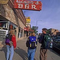 College students walk along Main Street in Bozeman, Montana