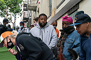 The San Francisco Homeless Outreach Team (HOT Team) employees collect basic information from unhoused individuals in San Francisco, CA on June 22, 2020, before relocating them to Safe Sleeping Sites, hotels or other homeless encampments. On average, the HOT Team allocated 50 hotel rooms per day, forcing them to relocate the majority of individuals to Safe Sleeping Sites.