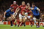 Gareth Davies of Wales makes a break. Rugby World Cup 2015 pool A match, Wales v Uruguay at the Millennium Stadium in Cardiff, South Wales  on Sunday 20th September 2015.<br /> pic by  Andrew Orchard, Andrew Orchard sports photography.