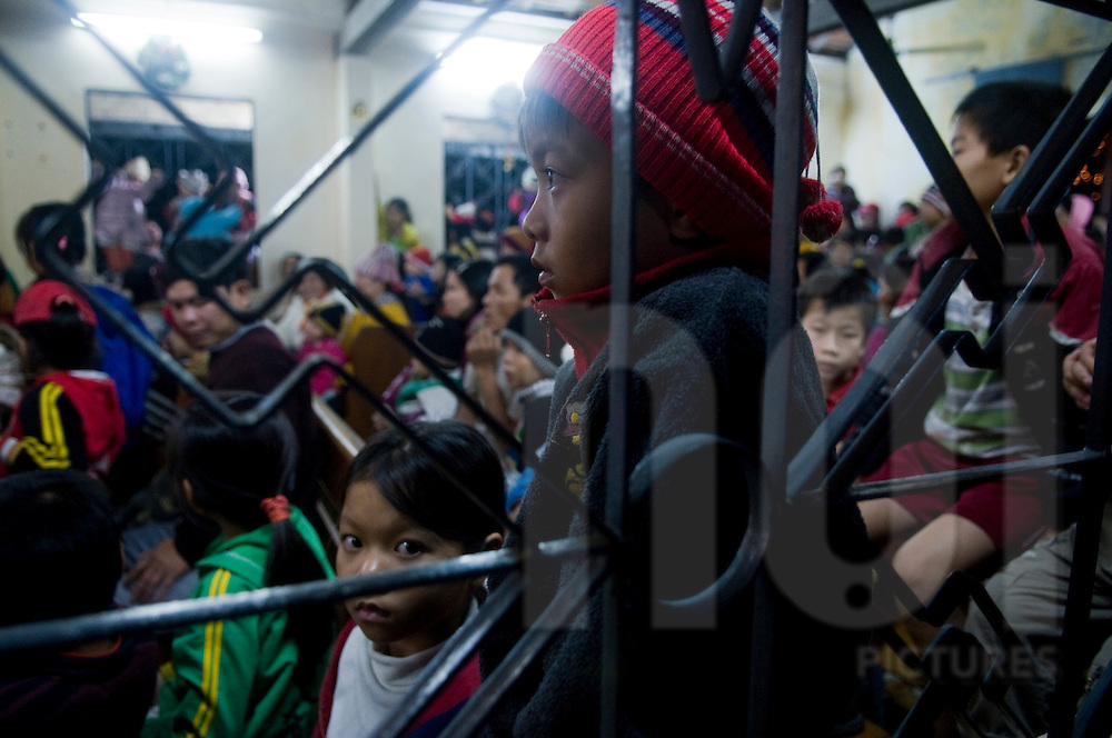 Christmas Eve mass in a church of Tam Hai village int the province of Quang Nam, Vietnam, Southeast Asia