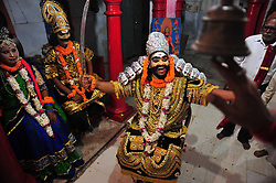 September 26, 2016 - Allahabad, Uttar Pradesh, India - Allahabad: A Hindu devotee push a bell as he perfoming prayer to an artist dressed as Demon Kind Ravan during a religious procession Ravan ki Barat in Allahabad on September 26, 2016, held to mark the Dussehra festival. The name Dussehra is derived from Sanskrit Dasha-hara literally means removal of ten referring to Lord Rama's victory over the ten-headed demon king Ravana. Dussehra is celebrated on the tenth day of the month of Ashwin according to the Hindu calendar which corresponds to September or October of the Gregorian calendar. (Credit Image: © Prabhat Kumar Verma via ZUMA Wire)