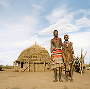 Portrait of Hamer couple in front of their hut in Turmi, Lower Omo Valley, Ethiopia