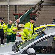 14.11.2016          <br /> Major winter safety and wellbeing campaign launched by Limericks Public Services. <br /> <br /> Garda Brian O'Dwyer, Limerick Traffic Corps hands out High Visability Jackets and information leaflets during a combined checkpoint between Limerick City and County Council, the HSE and An Garda Siochana on the Dock Road Limerick. Picture: Alan Place