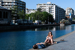 People are enjoying the sunshine in Paris during COVID-19 as a strict lockdown is effective to stop the spread of the Coronavirus disease. Shot in Paris, France on April 27, 2020. Photo by Aurore Marechal/ABACAPRESS.COM