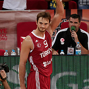 Turkey's player Semih Erden celebrate with the trophy after their their Adidas Istanbul Cup 2012 basketball final match Germany between Turkey at the Abdi ipekci Arena in Istanbul Turkey on Friday 03 August 2012. Turkey won 71-67. Photo by TURKPIX
