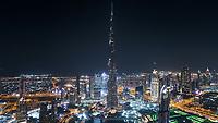Aerial view of Burj Khalifa tower illuminated at night in Dubai, United Arab Emirates.
