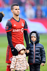 October 28, 2018 - Toronto, ON, U.S. - TORONTO, ON - OCTOBER 28: Sebastian Giovinco (10) of Toronto FC stands for the national anthems with his children before the MLS Decision Day match between Toronto FC and Atlanta United FC on October 28, 2018, at BMO Field in Toronto, ON, Canada. (Photograph by Julian Avram/Icon Sportswire) (Credit Image: © Julian Avram/Icon SMI via ZUMA Press)