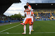 Goal Blackpool forward (on loan from Everton) Ellis Simms (19) scores a goal and celebrates  with Blackpool forward Keshi Anderson (8) 0-3  during the EFL Sky Bet League 1 play off 1st leg match between Oxford United and Blackpool at the Kassam Stadium, Oxford, England on 18 May 2021.