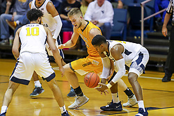 Nov 24, 2018; Morgantown, WV, USA; Valparaiso Crusaders center Derrik Smits (21) and West Virginia Mountaineers forward Sagaba Konate (50) dive for a loose ball during the second half at WVU Coliseum. Mandatory Credit: Ben Queen-USA TODAY Sports