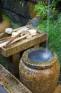 Japanese holy water is used in a similar way to Catholic holy water.  It's used for cleansing before ceremonies. Kyoto, Japan.