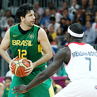 31 July 2012: Brazil Guilherme Giovannoni looks to pass the ball during 67-62 Team Brazil victory over Team Great Britain, during the men's basketball preliminary, at the Basketball Arena, in London, Great Britain.