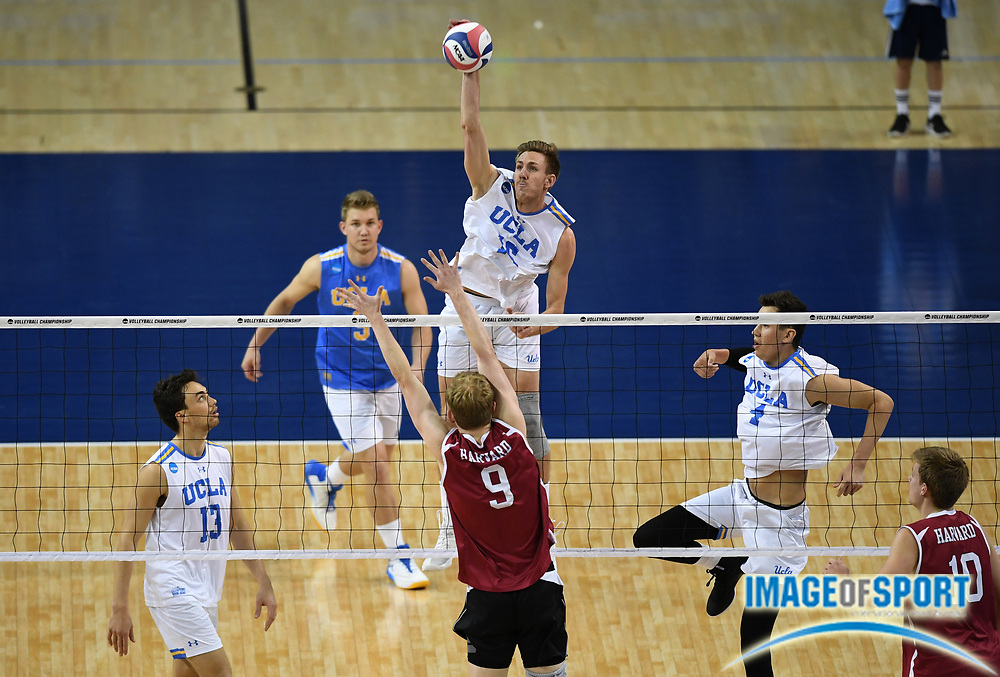 UCLA Bruins outside hitter Jake Arnitz (15) spikes the ball against the Harvard Crimson during the opening round game of the NCAA college volleyball championship in Los Angeles, Tuesday, May 1, 2018. UCLA defeated Harvard 23-25, 25-21, 25-11, 25-21.