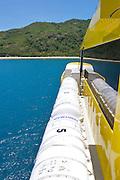 The Yasawa Flyer ferry heaves to at an island in the Yasawa Islands, Fiji.