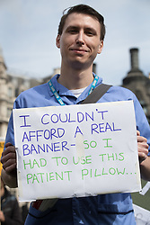 © Licensed to London News Pictures. 06/09/2017. London, UK. A nurse holds a placard during a demonstration in Parliament Square. The Royal College of Nursing is campaigning against the Government's one per cent cap on public sector pay. Photo credit: Peter Macdiarmid/LNP