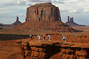 Tourists stop to view Merrick Butte from John Ford's Point in Monument Valley on the southern border of Utah with northern Arizona. The valley lies within the range of the Navajo Nation Reservation. The Navajo name for the valley is Tsé Bii' Ndzisgaii - Valley of the Rocks.