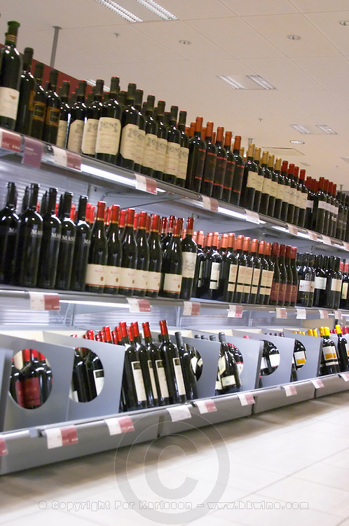 The interior of Systembolaget, the Swedish retail monopoly stores for alcohol wine beer spirits with bottles displayed on self service shelves Stockholm, Sweden, Sverige, Europe